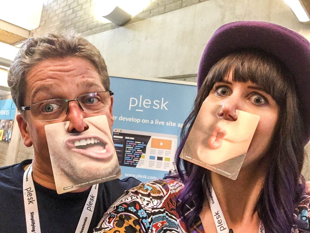 WordCamp Nijmegen, Jörg Strotmann and Carole Olinger having fun with Plesk swag