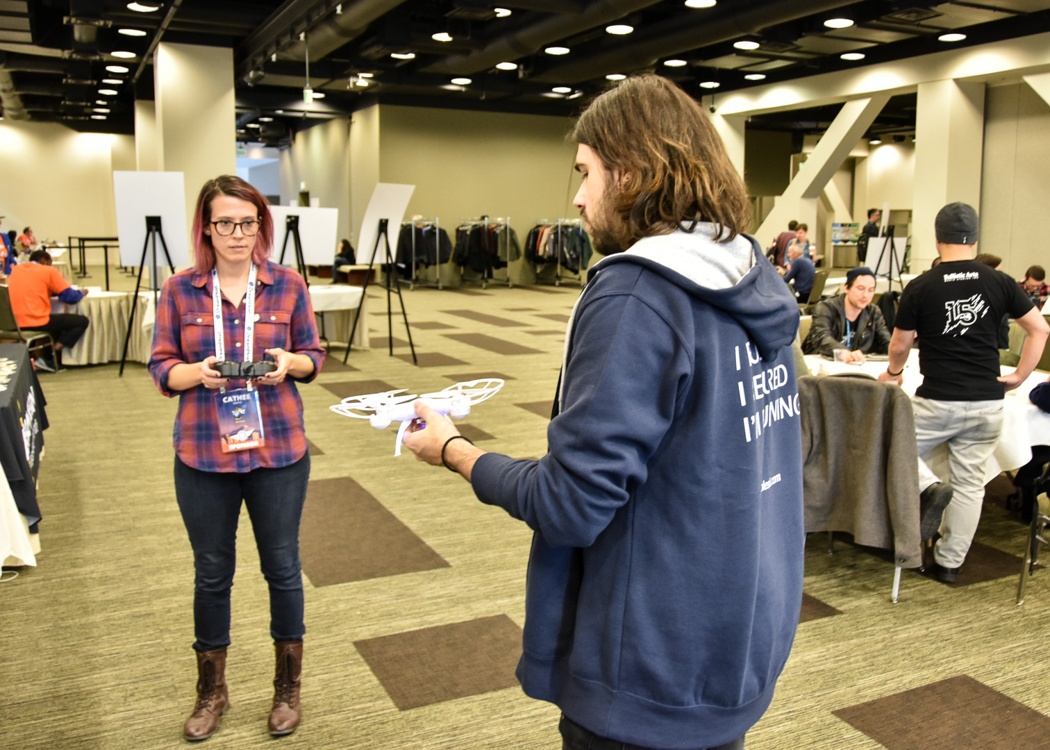 WordCamp Seattle, Robert Aguilar demonstrating the Plesk drones to Cathee Smith from DreamHost