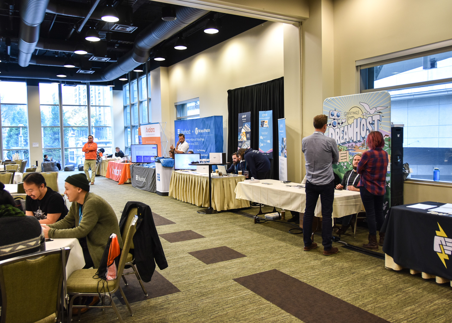 WordCamp Seattle, sponsor area with Pantheon, DreamHost, Plesk, Bluehost, Avalara and GoDaddy